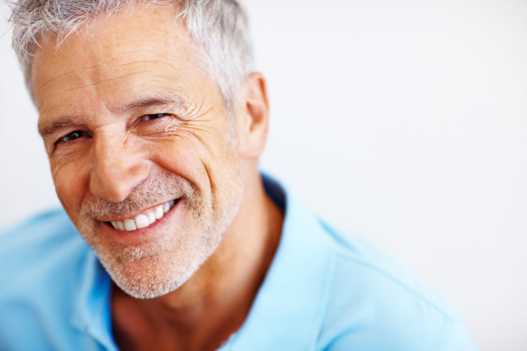 Full mouth restoration or rehabilitation to repair worn, missing or broken teeth